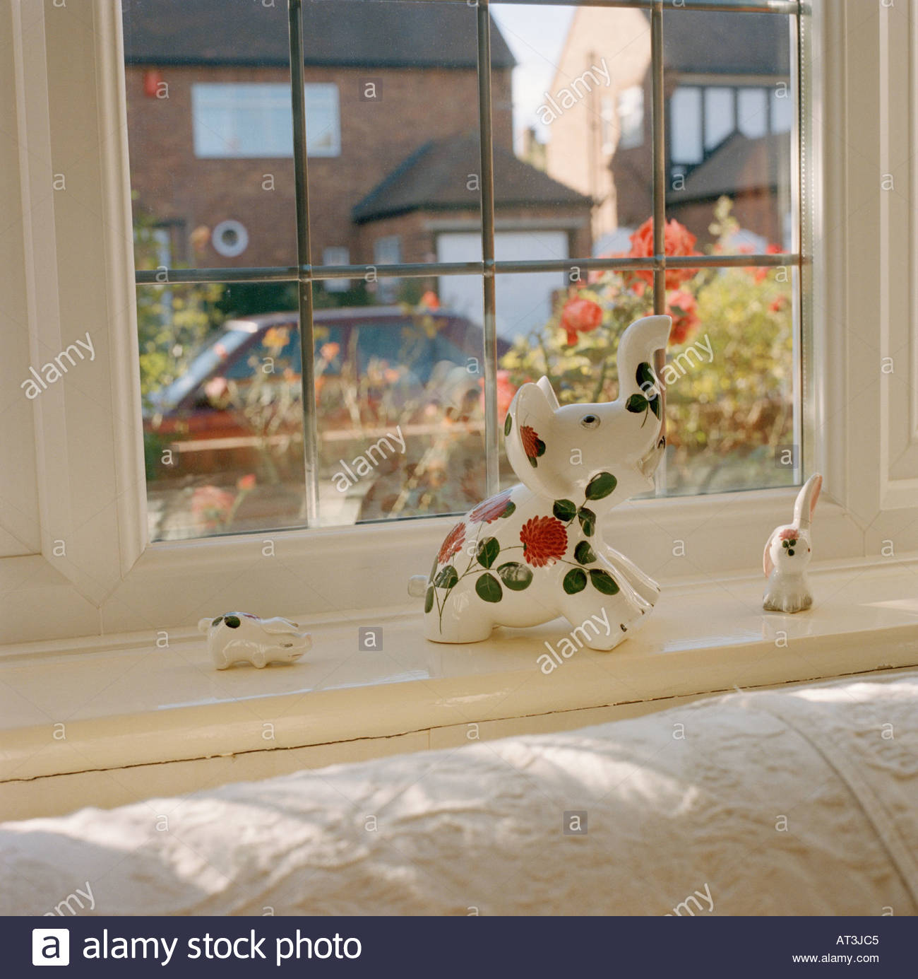 Stock Photo   Window sill in living room with ornament. Window sill in living room with ornament Stock Photo  Royalty Free