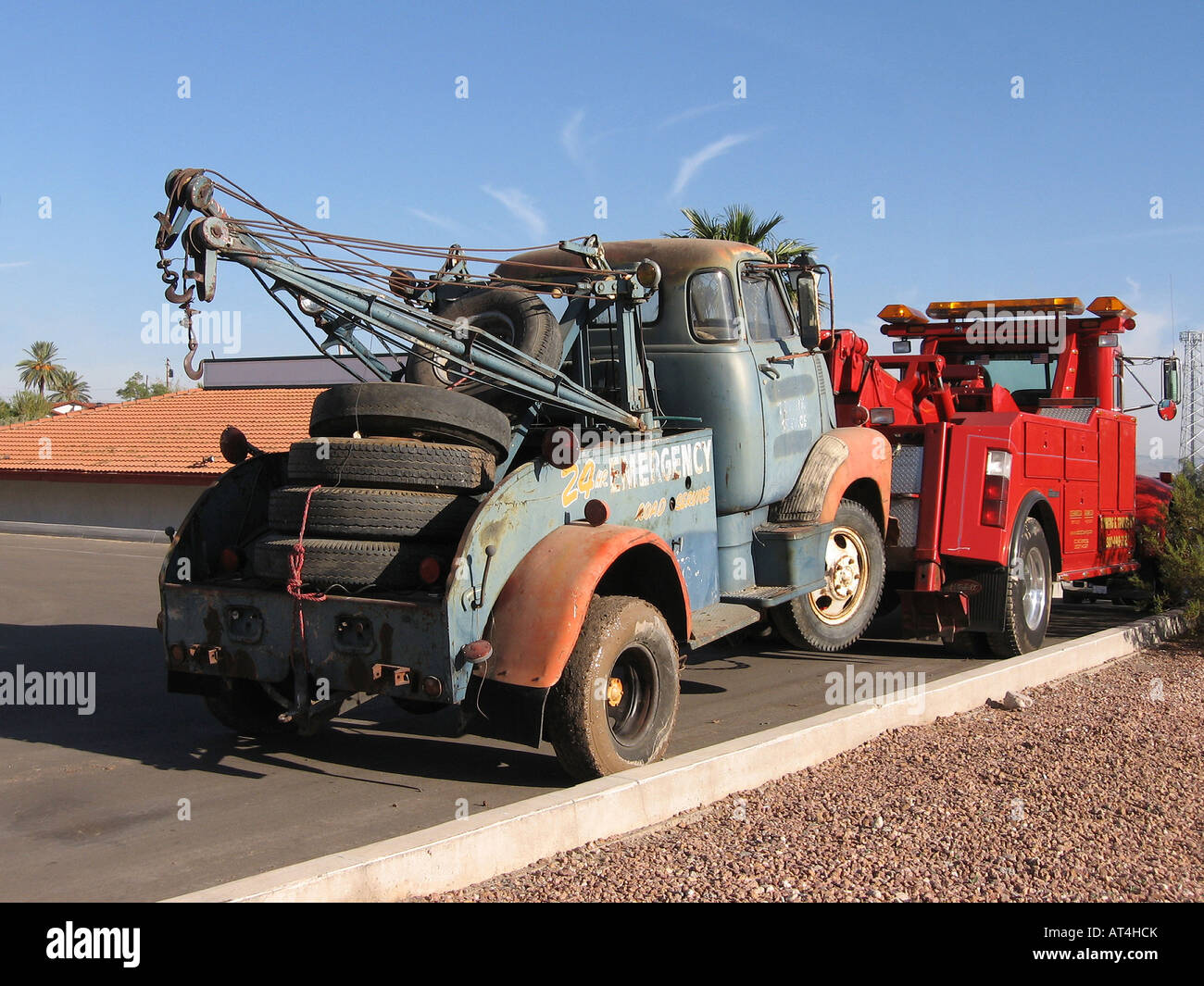 New tow truck towing old tow truck stock image