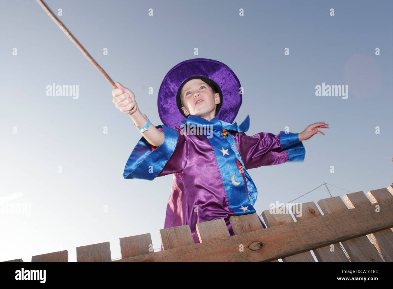 Boy in a wizard costume with magic wand Stock Photo, Royalty Free ...