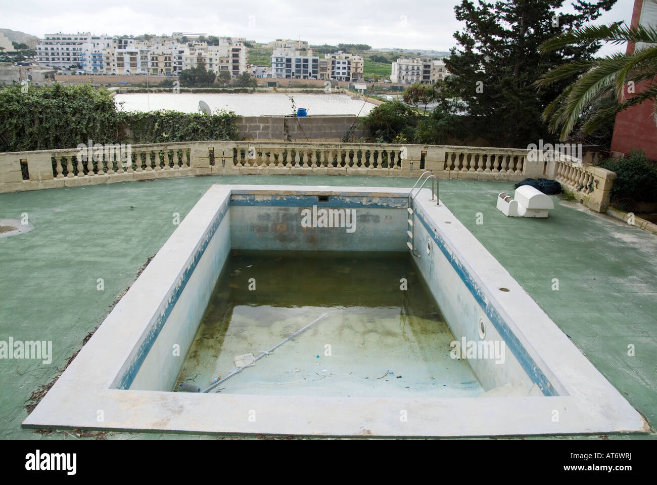 Empty swimming pool bad hotel rough dirty area stock photo for Empty swimming pool