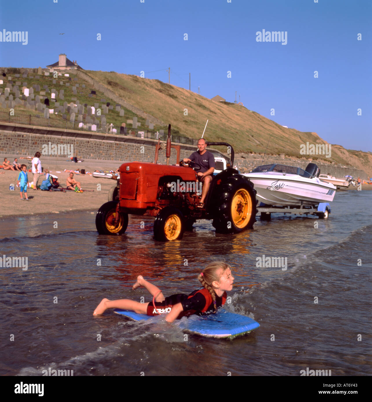 Tractor Pull Boats : A tractor pulling boat on trailer the beach at