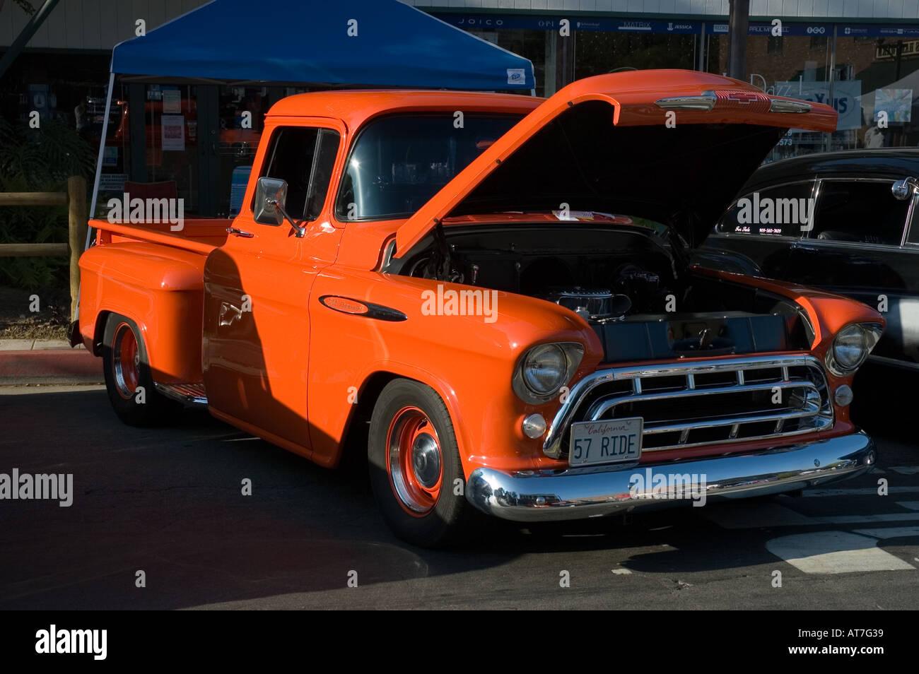 Los angeles california car show antique customized 1957 57 chevy chevrolet pickup truck 3100 orange