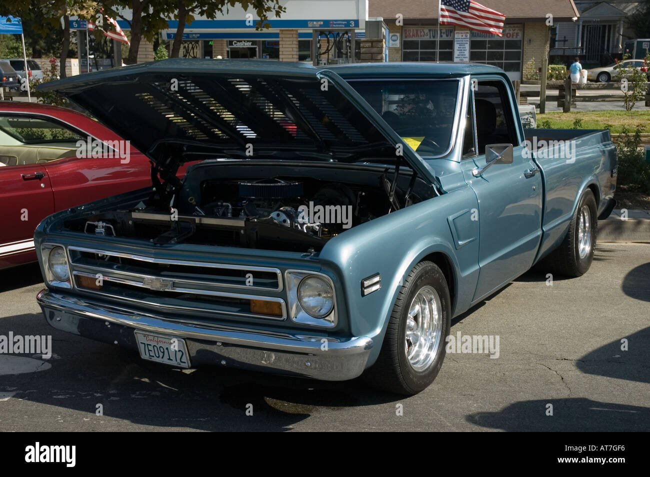 Los angeles california car show antique customized chevrolet chevy pickup pick up truck open hood engine light blue