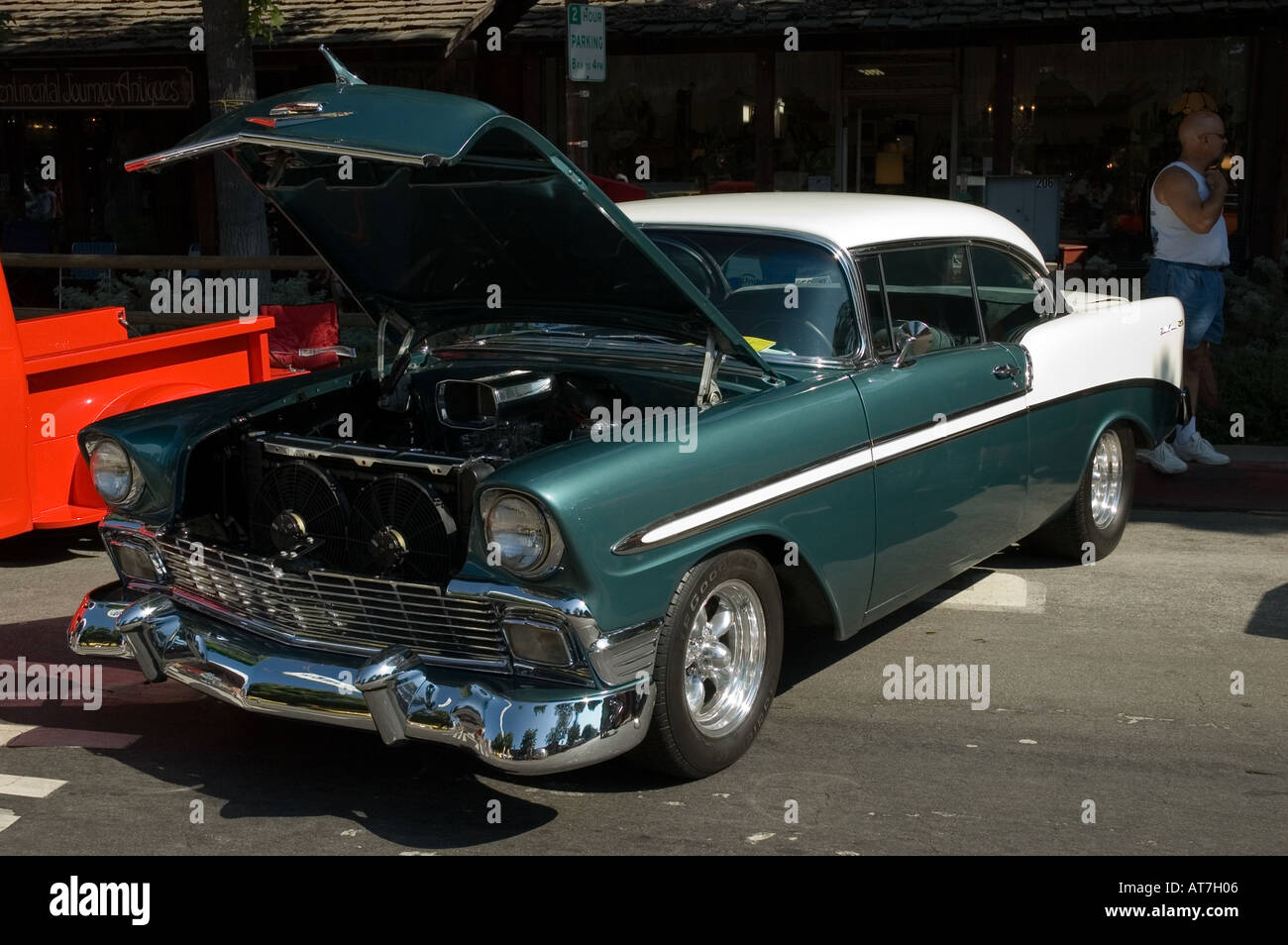 Los angeles california car show antique customized chevy chevrolet bel air green white open hood engine
