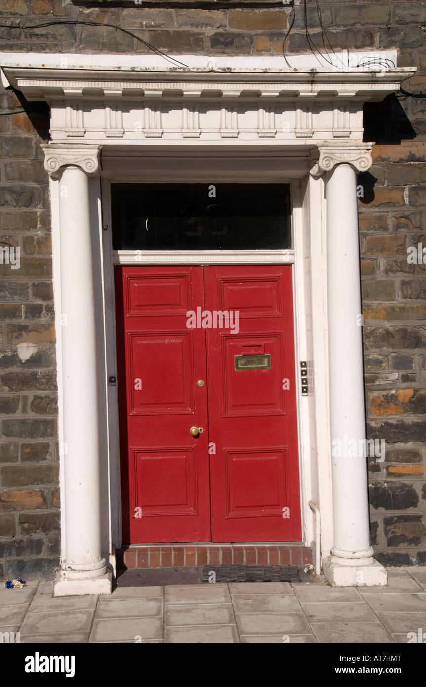 Red Painted Wooden Double Front Door With Columns And Portico On A Stock Phot