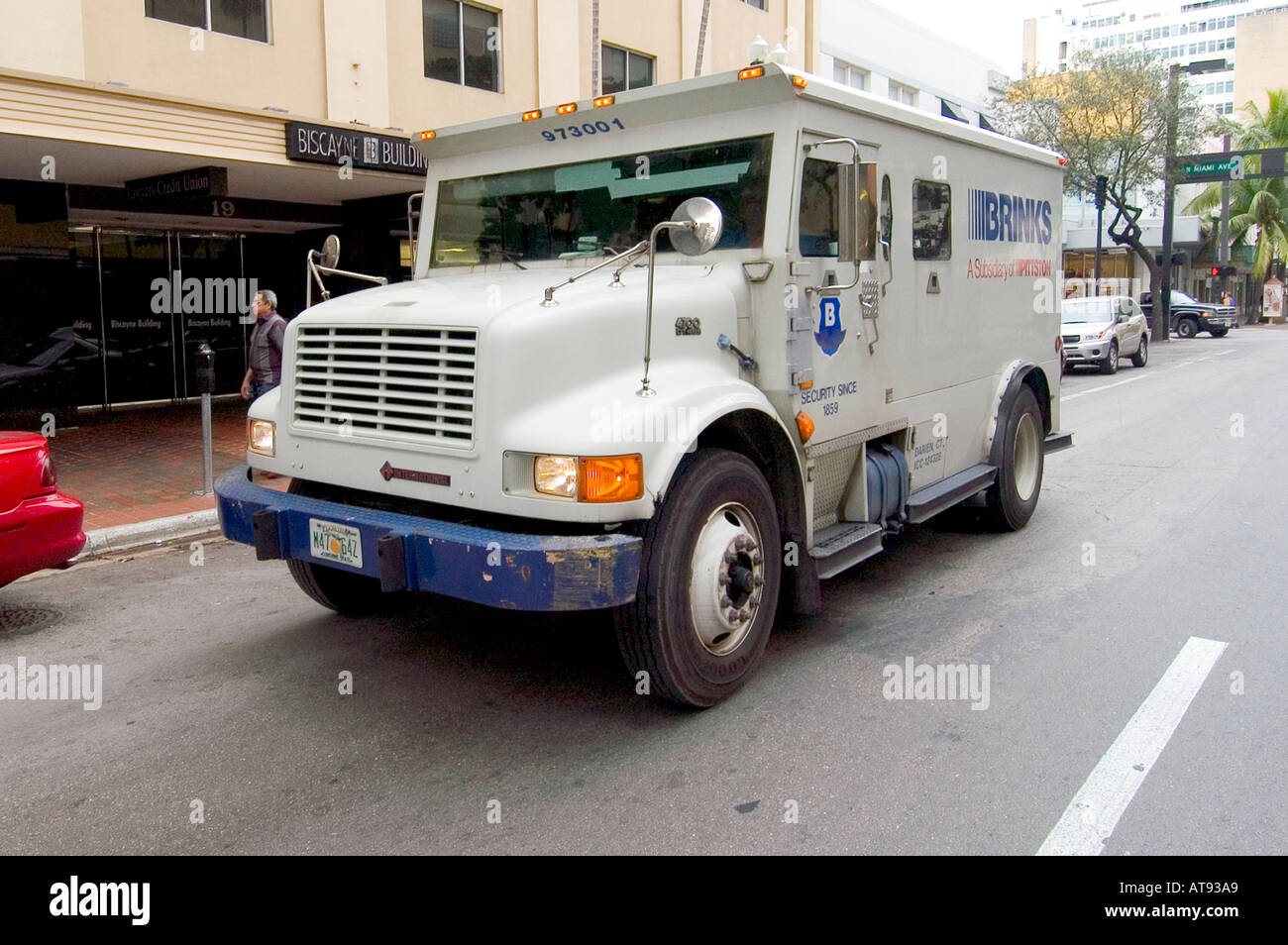 Miami florida street life brinks armored truck picks up and delivers cash money to banks and