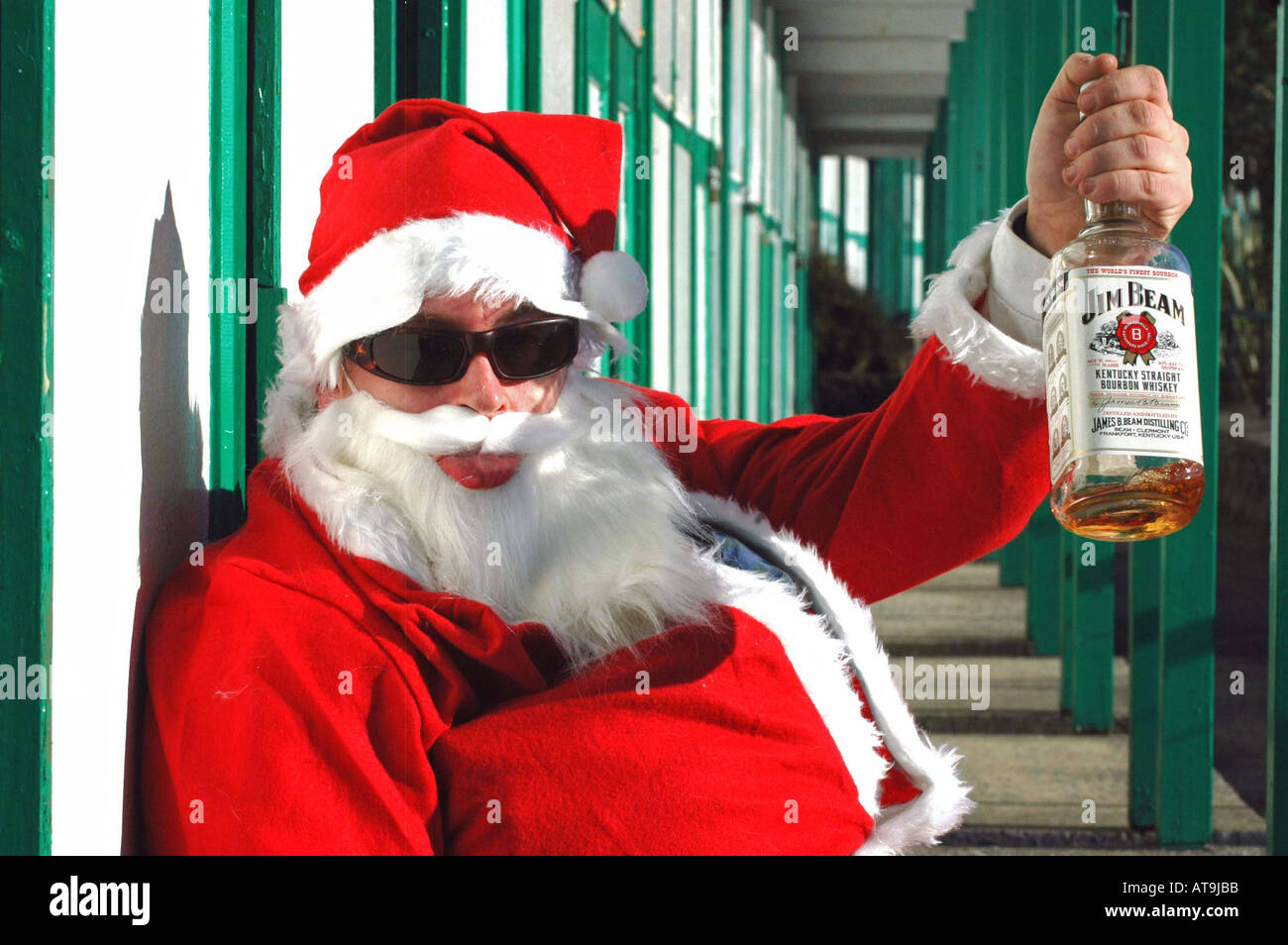 a drunk father christmas drinking whisky stock photo