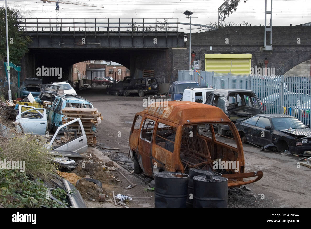 Abandoned wrecked cars and rubbish. Marshgate Lane, Stratford ...