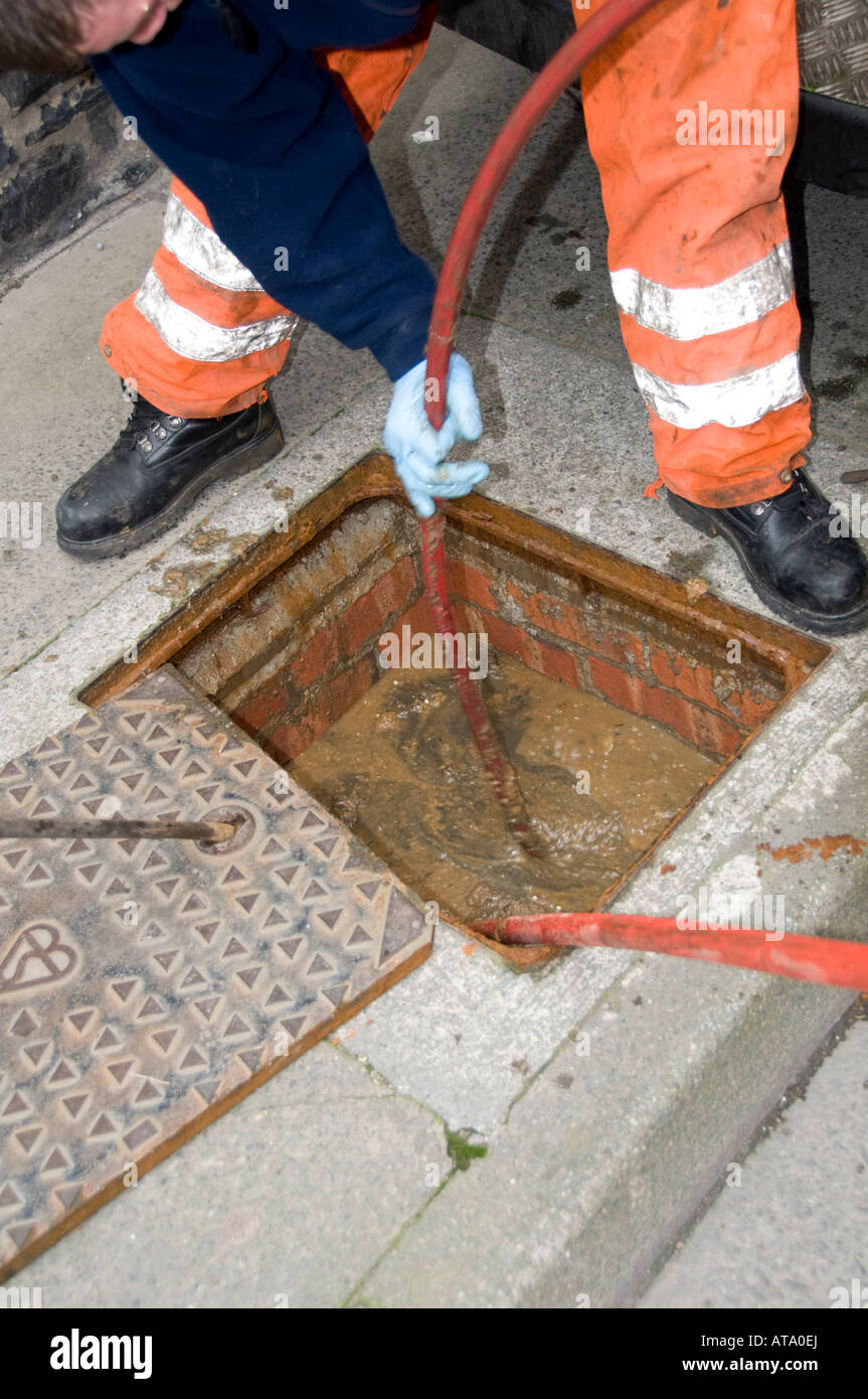 A Dyno Rod Worker Drain Clearing Blocked Drain Outside A