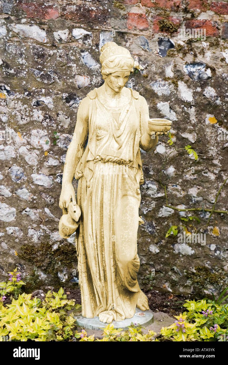 Garden Statue Of Ancient Greek Hand Maiden/ Priestess/ Roman Vestal Virgin    Stock