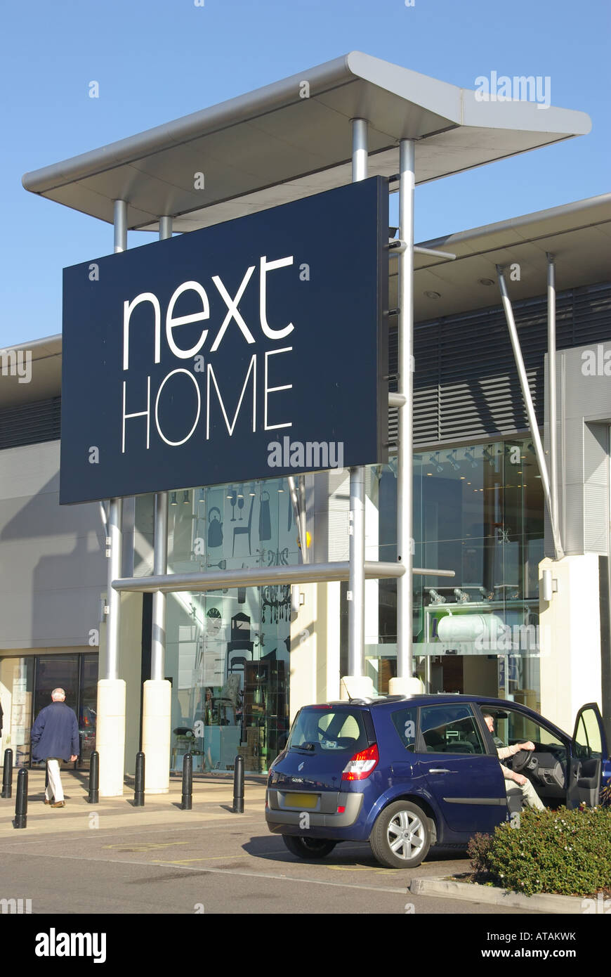 Next Home store sign and canopy over entrance at the Lakeside out of town retail park shopping complex with free car parking & Next Home store sign and canopy over entrance at the Lakeside out ...