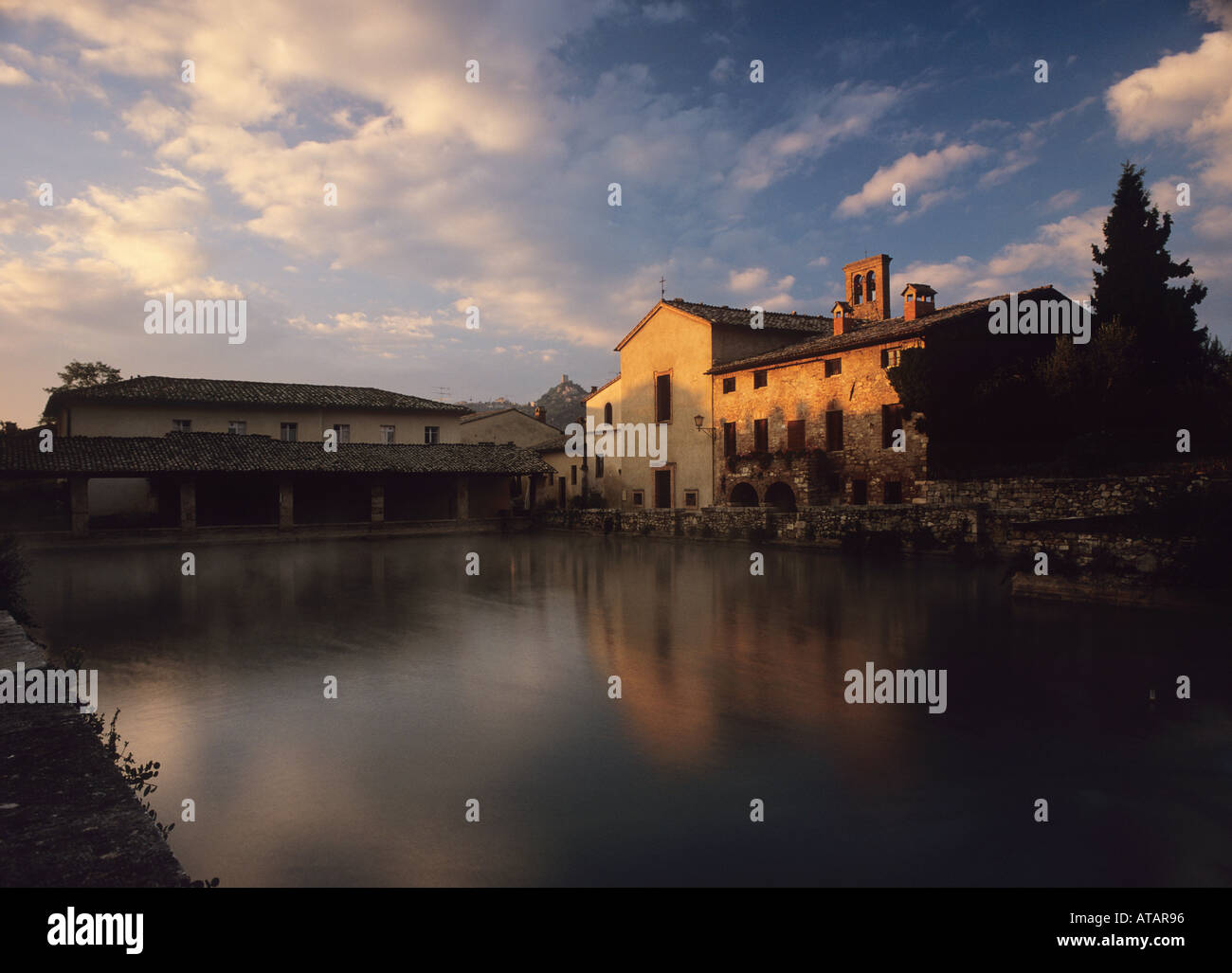 Historical Therm Bagno Vignoni at dawn with Rocca d\'Orcia in the ...