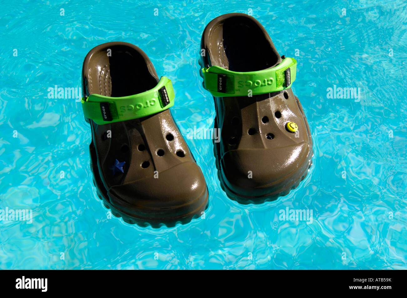 Crocs Chocolate Lime Offroad Footwear Swimming Pool Floating Shoes Stock Photo Royalty Free