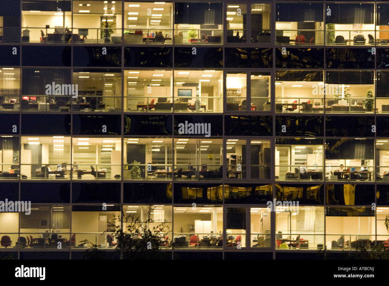 building an office. View Through The Windows In An Office Building At Night La Defense, France, Paris H