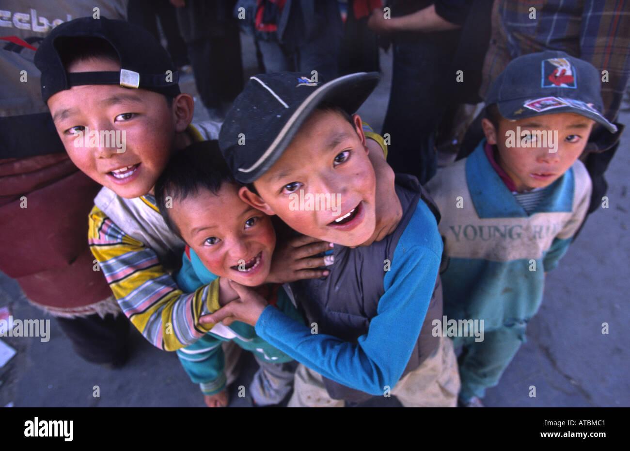 Tibetan Boys Litang Sichuan China Stock Photo Royalty Free  # Bois En Chaene