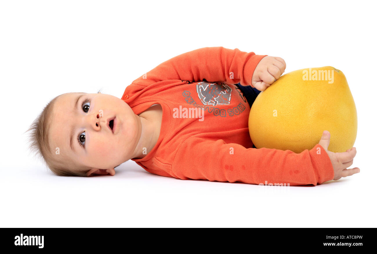baby lying on lateral position pomelo stock photo royalty stock photo baby lying on lateral position pomelo