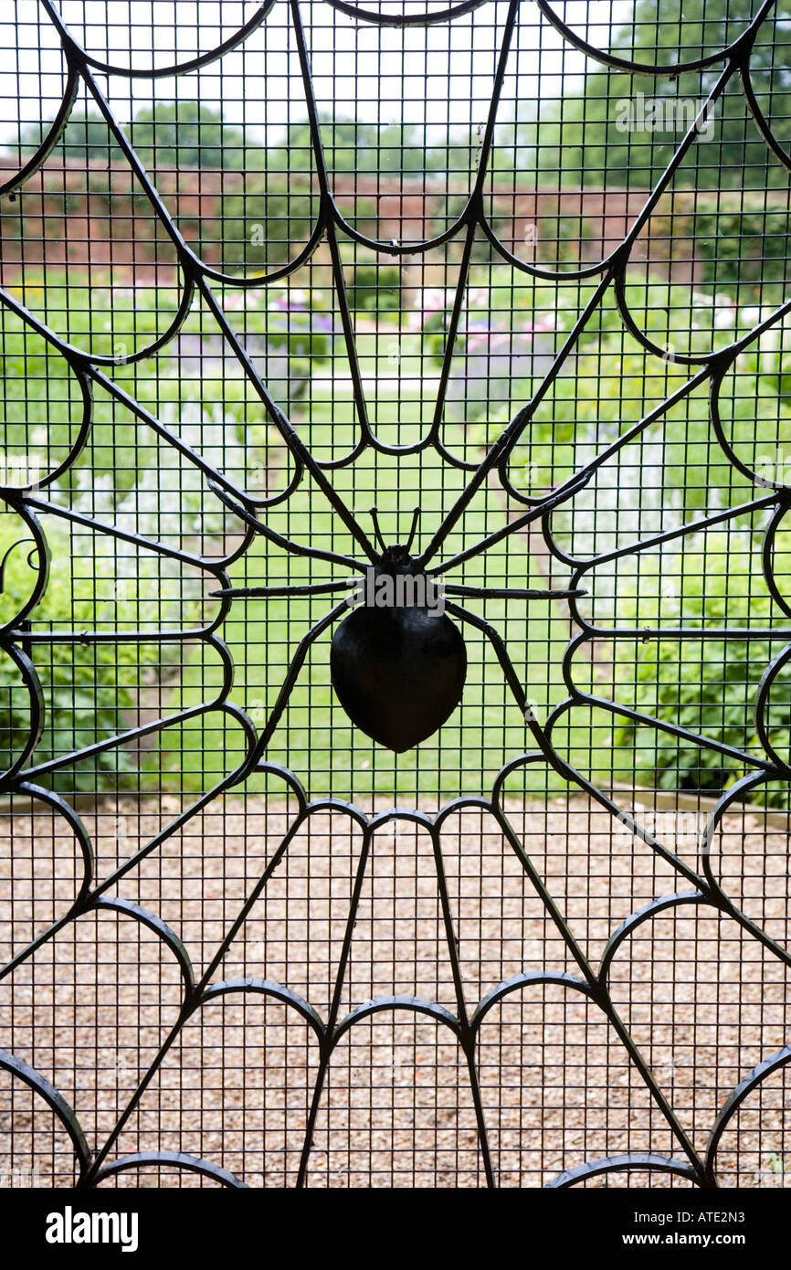 Wrought Iron Gate With Spider Web Design Stock Photo