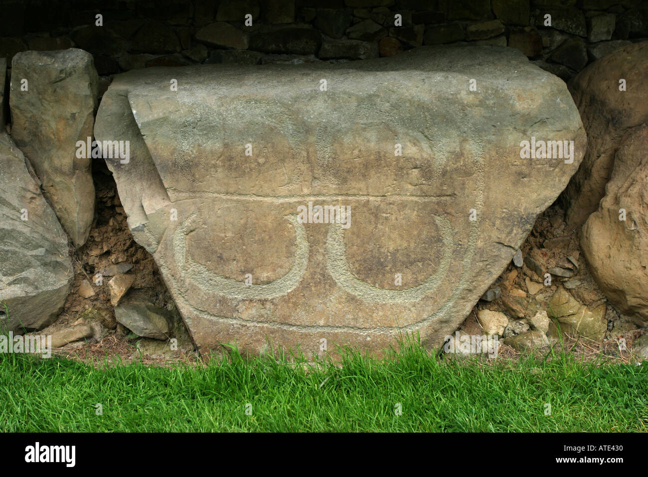 Kerb stone with carvings around the great mound at knowth