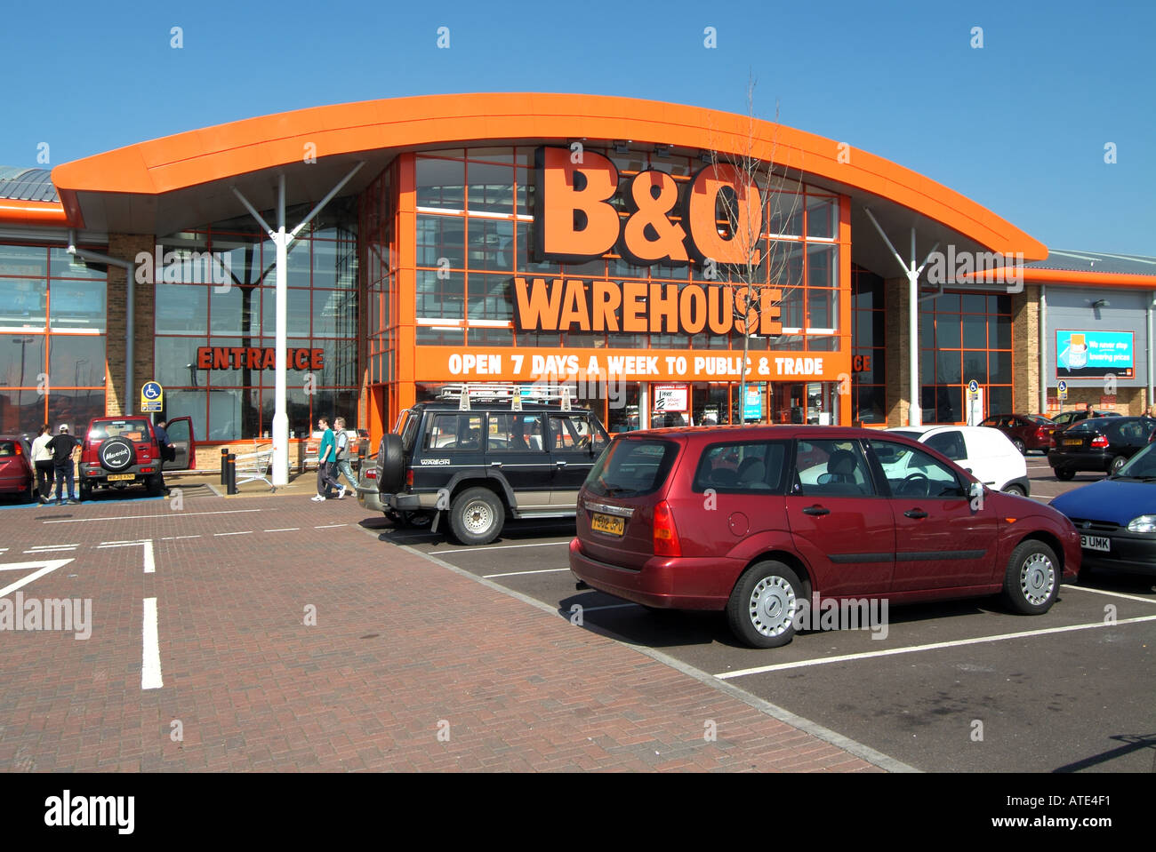 London home counties cars and vans parked outside B Q DIY warehouse store  open to both trade public customers