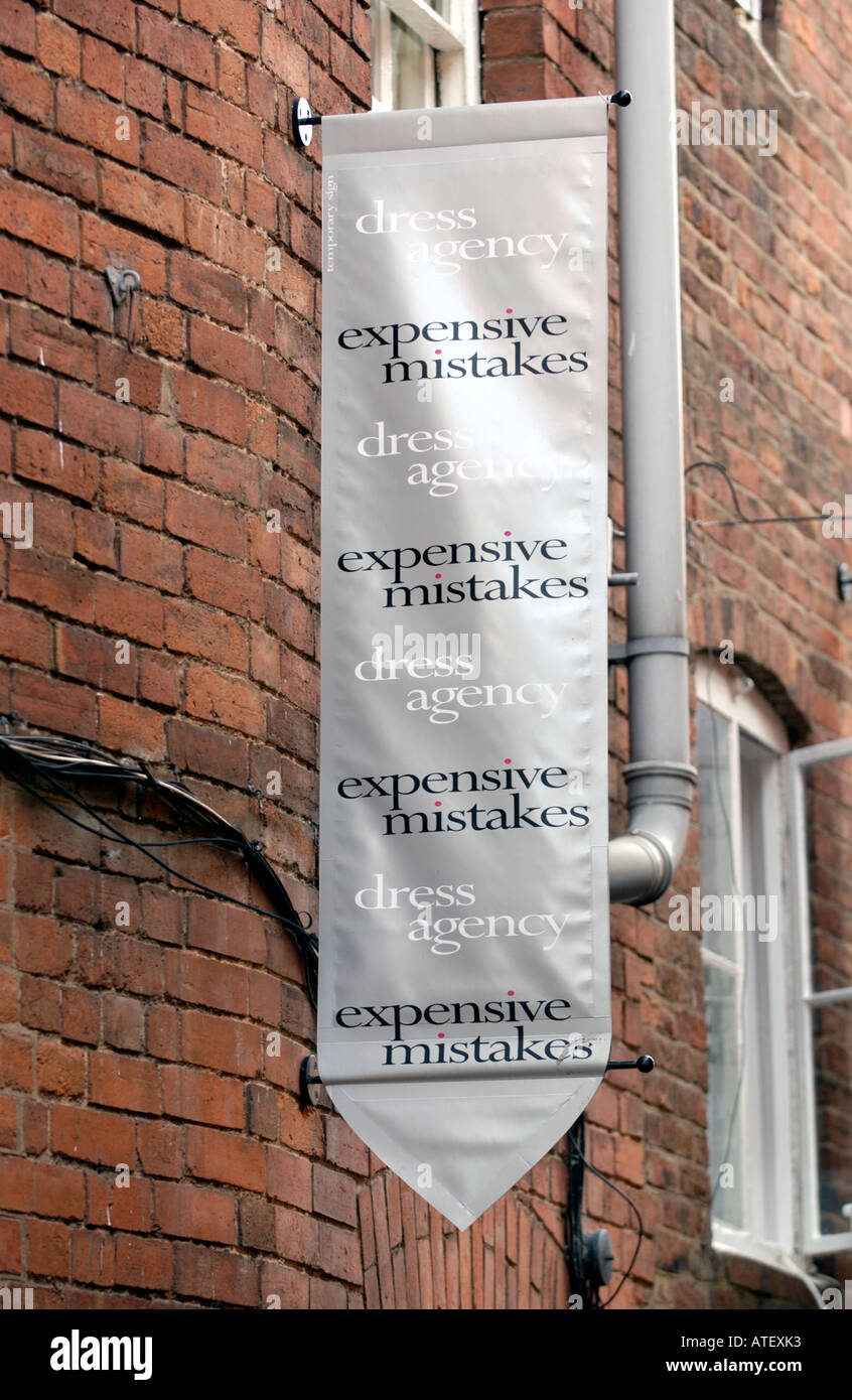 The dress agency - Hanging Sign On Wall For Expensive Mistakes Dress Agency In Ludlow Shropshire England Uk