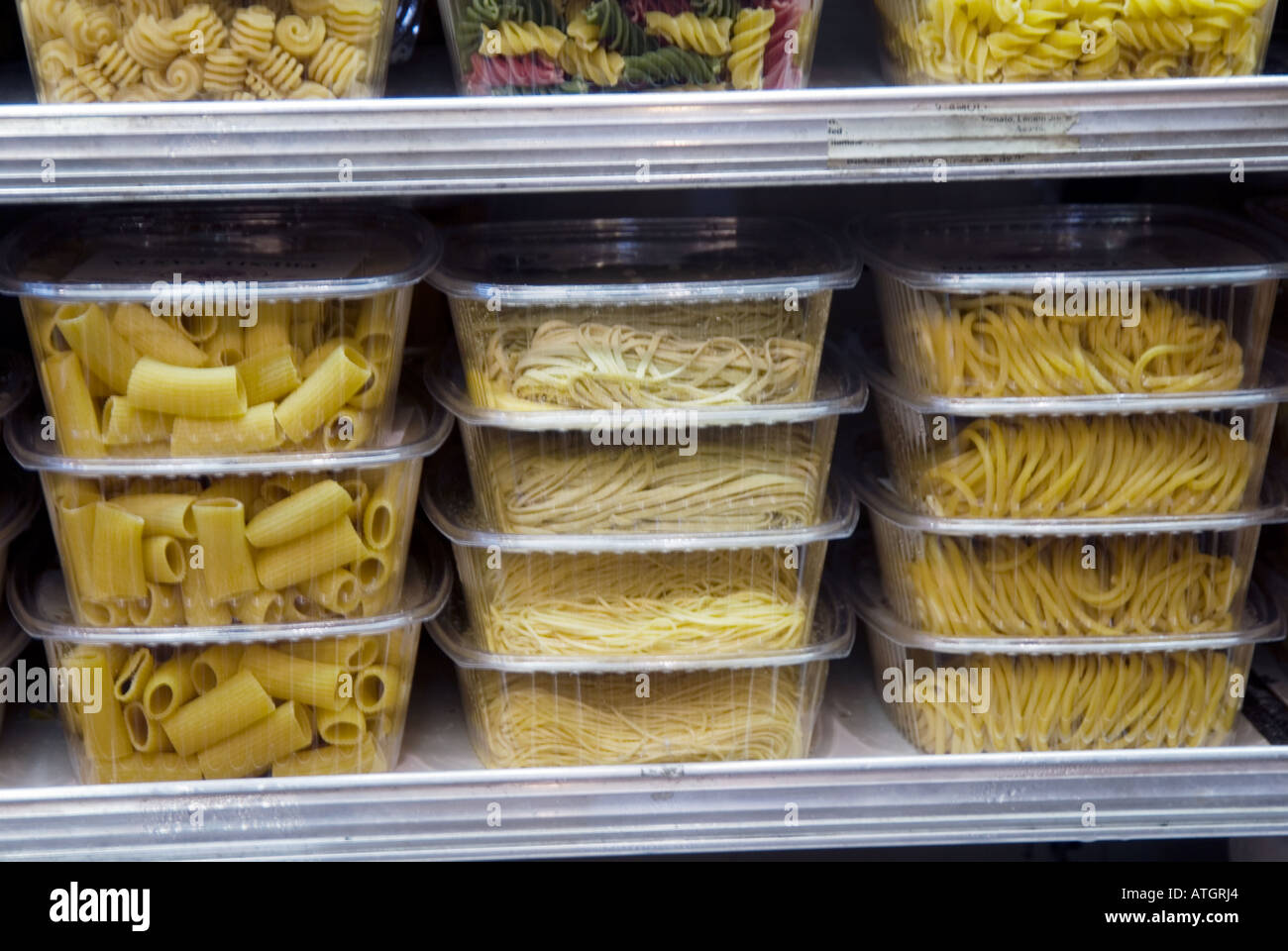 Fresh pasta in plastic containers in a gourmet food store for Cuisine store