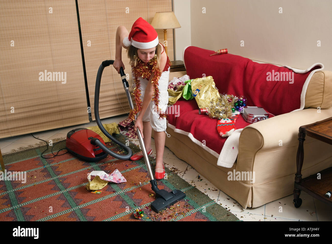 teenage girl vacuuming after Christmas party Stock Photo, Royalty ...
