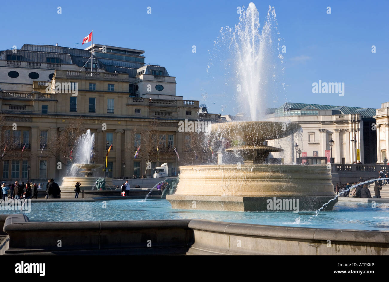 Water fountains canada - Stock Photo Water Fountain Trafalgar Square And Dolphin Statue National Gallery Day Time Spurting Man Canada Canadian Flag Embassy Uk