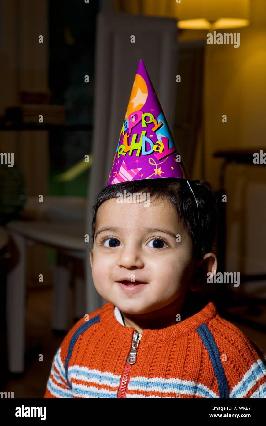 One Year Old Baby Boy Wearing Happy Birthday Cone Hat