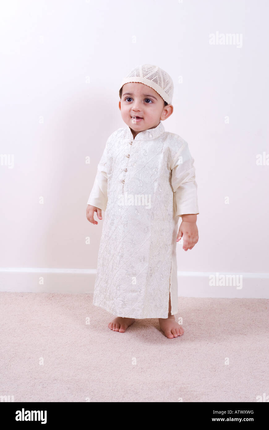 One year old Arabic boy wearing traditional Islamic outfit ...