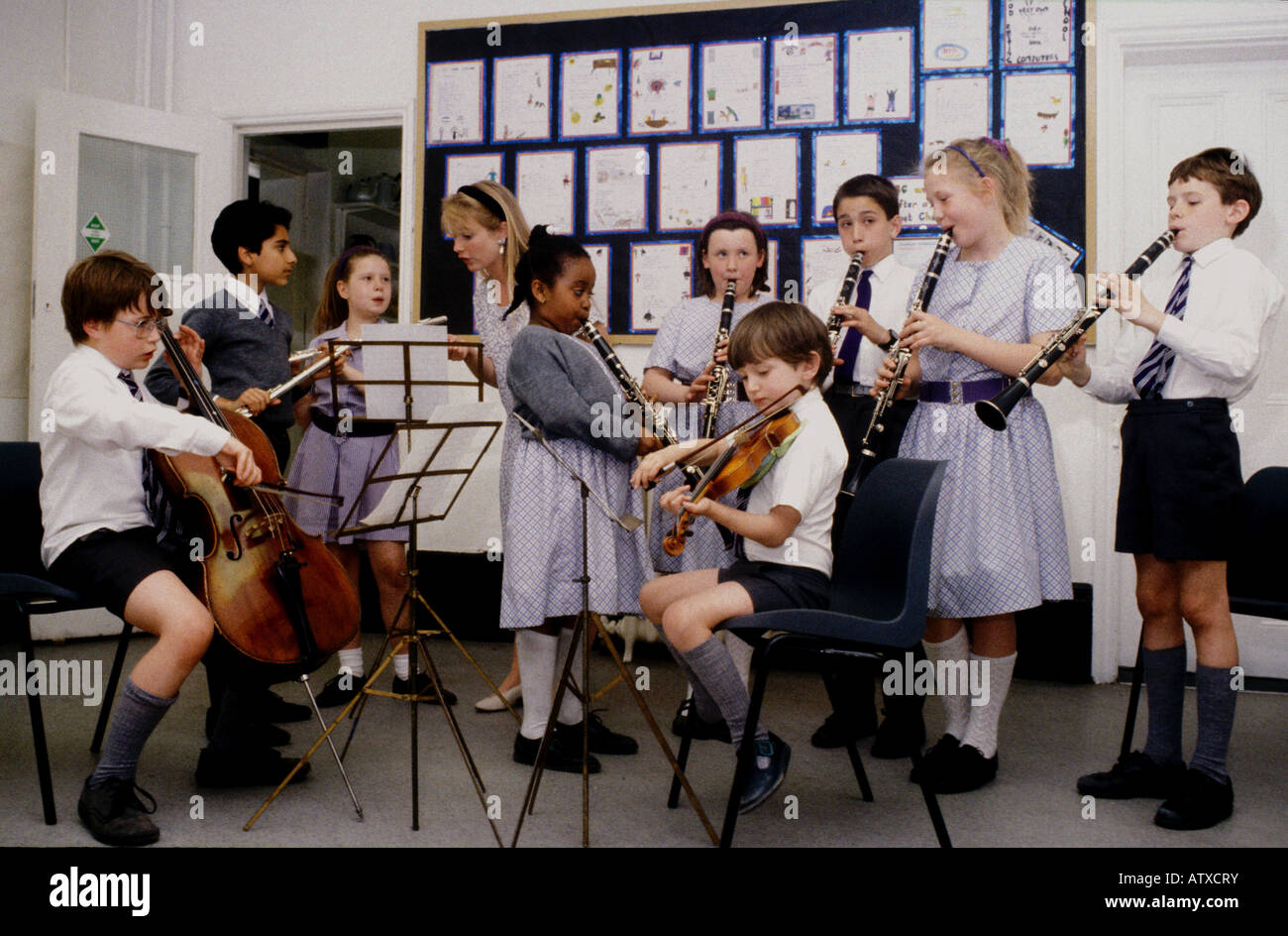 primary school orchestra with children playing range of string and stock photo royalty free. Black Bedroom Furniture Sets. Home Design Ideas
