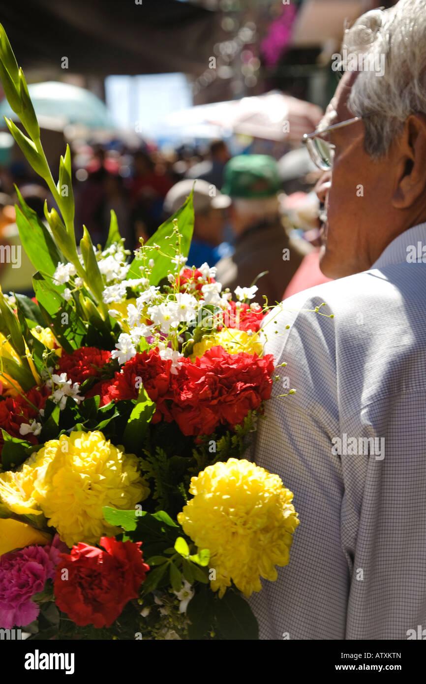 Mexico guanajuato older mexican man holding bouquet of flowers for mexico guanajuato older mexican man holding bouquet of flowers for day of the dead celebration izmirmasajfo Image collections