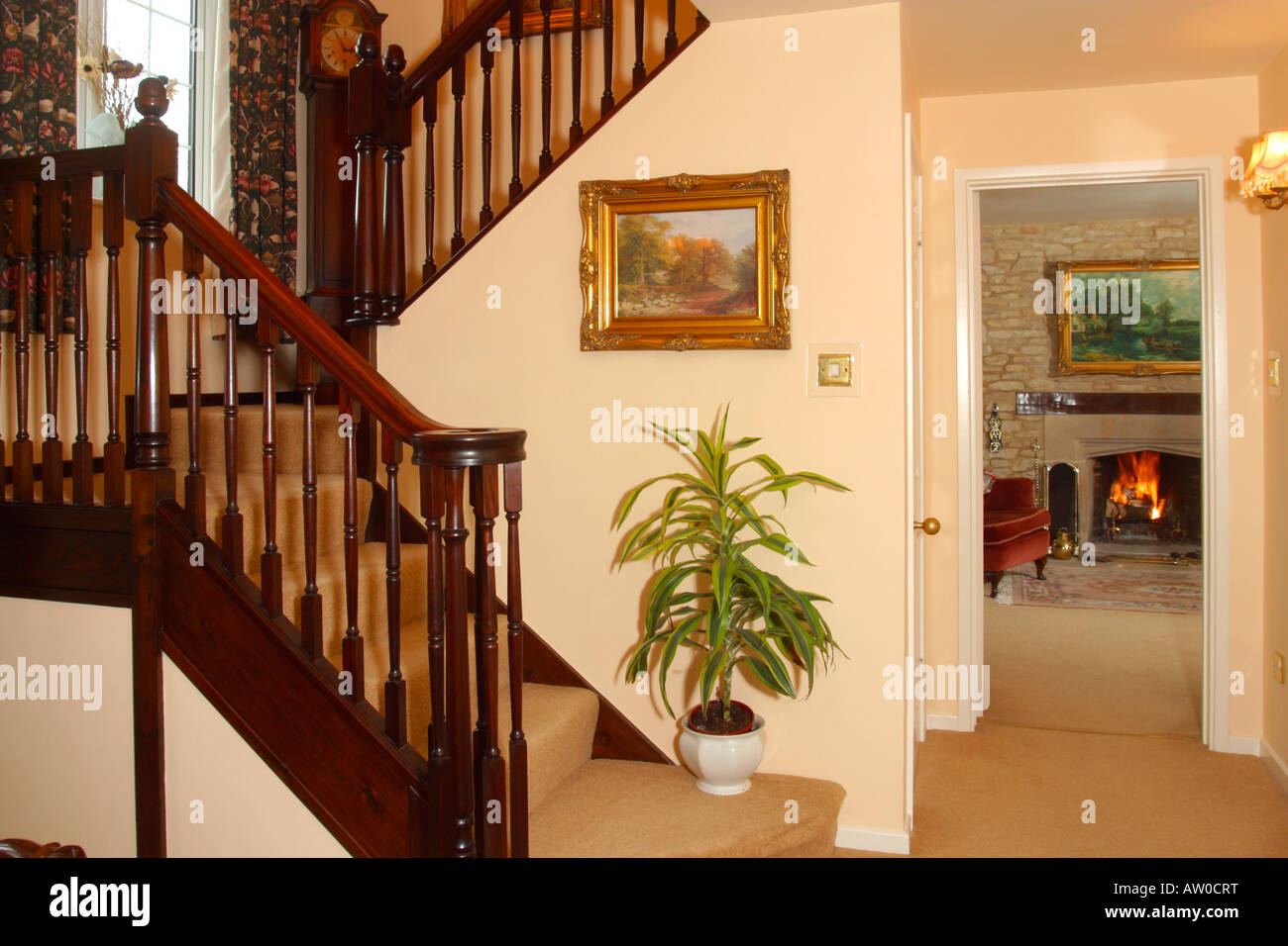 Stock Photo   Traditional Hall Stairs And View To Open Fire In Living Room Part 33