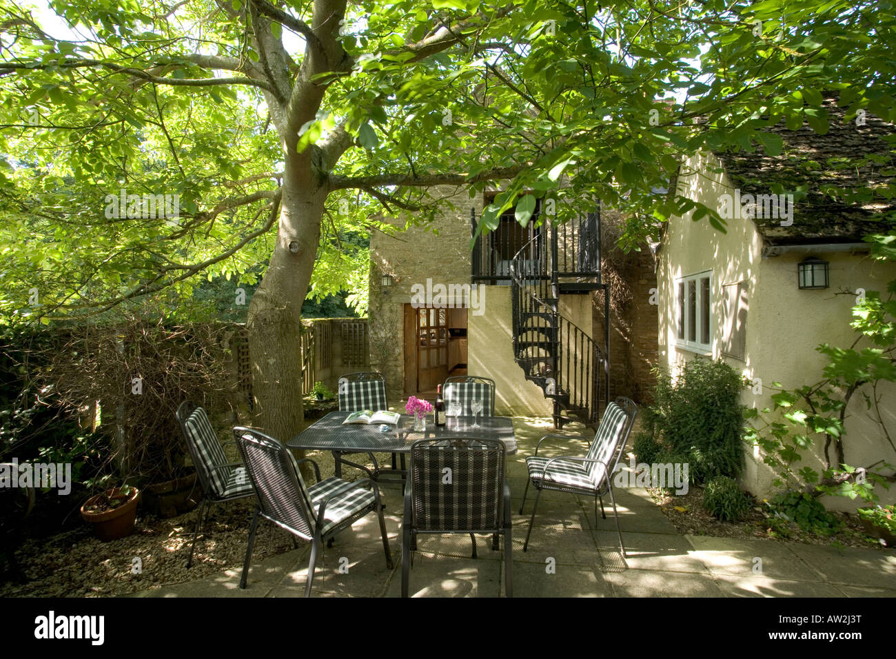 Summer Table And Chairs Part - 40: Dappled Shade On A Summer Garden Table And Chairs