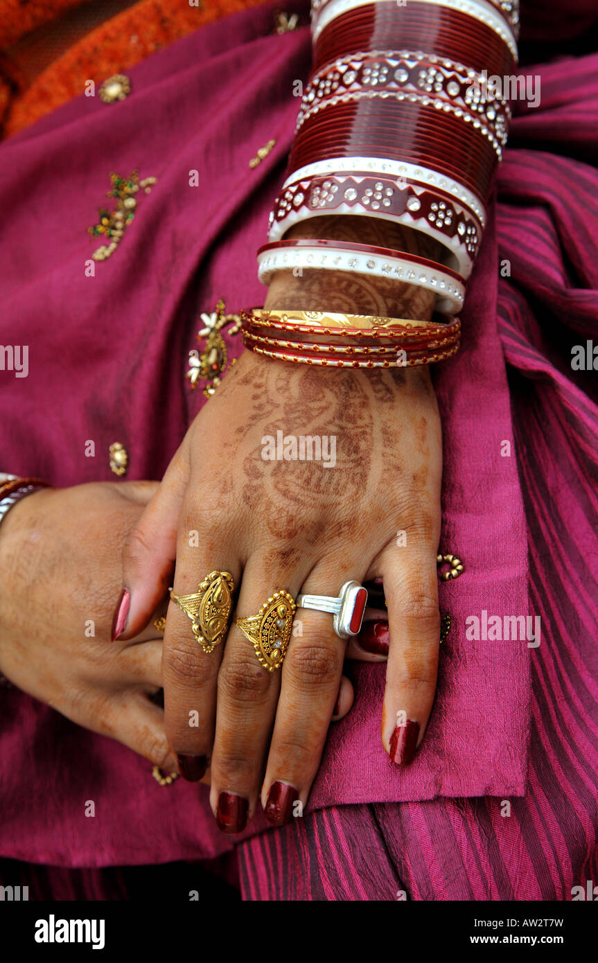 Beautiful decorated hands of an Indian women rings bangles and a ...