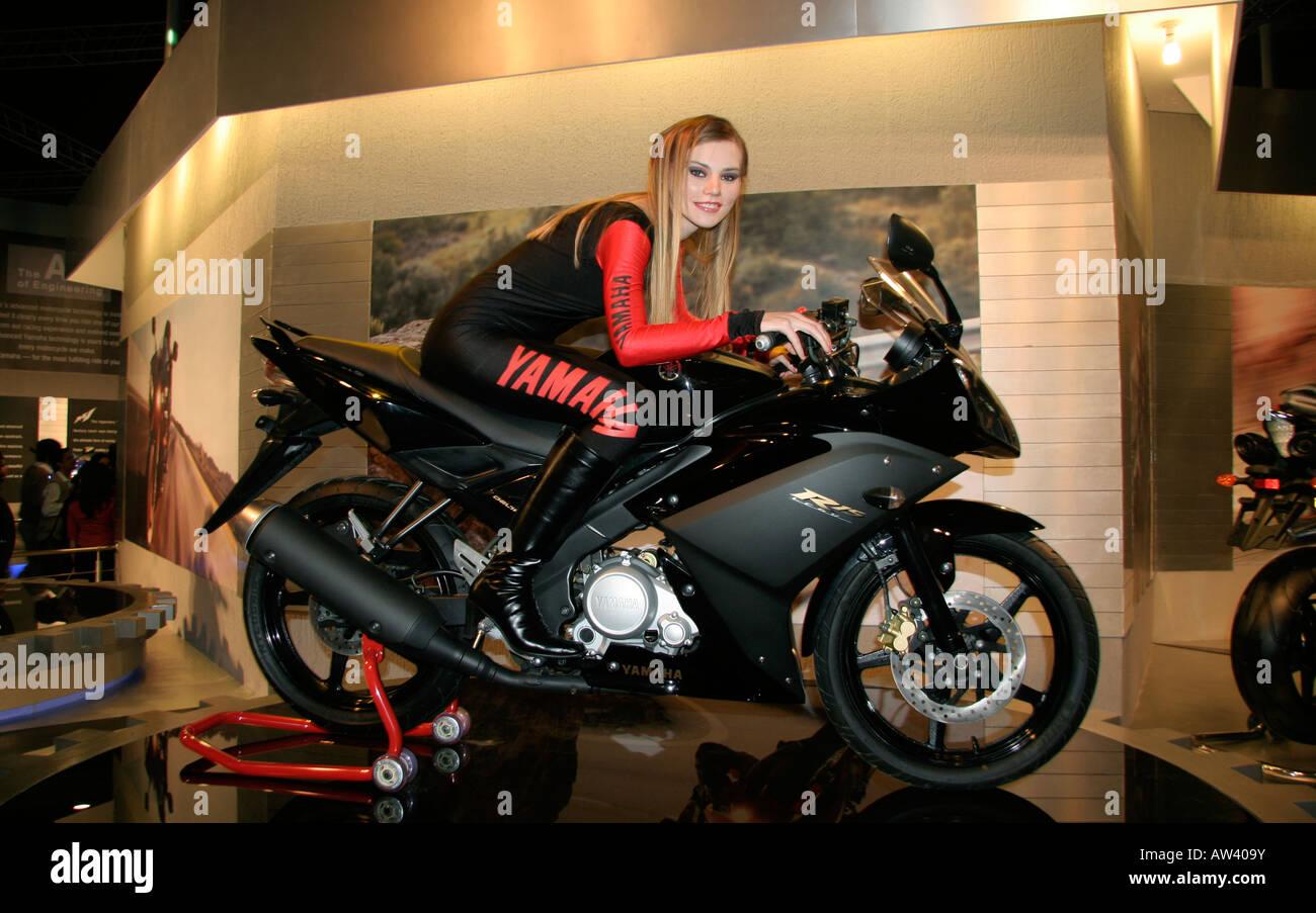 Yamaha motorcycle gloves india - Young Blond Model On Yamaha Motorcycle At Autoexpo Delhi India Stock Image