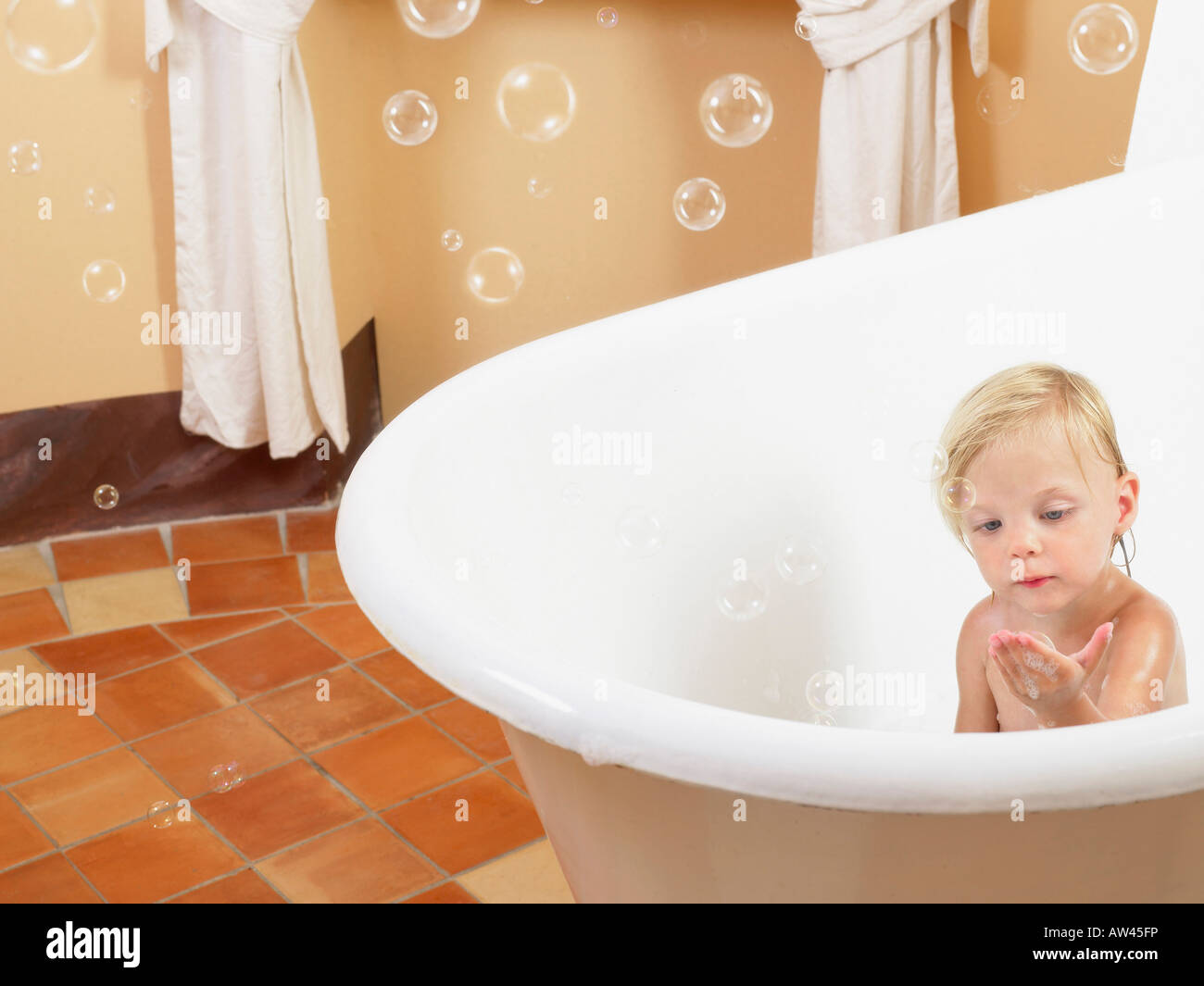 little girl taking a bath bubbles stock photo royalty