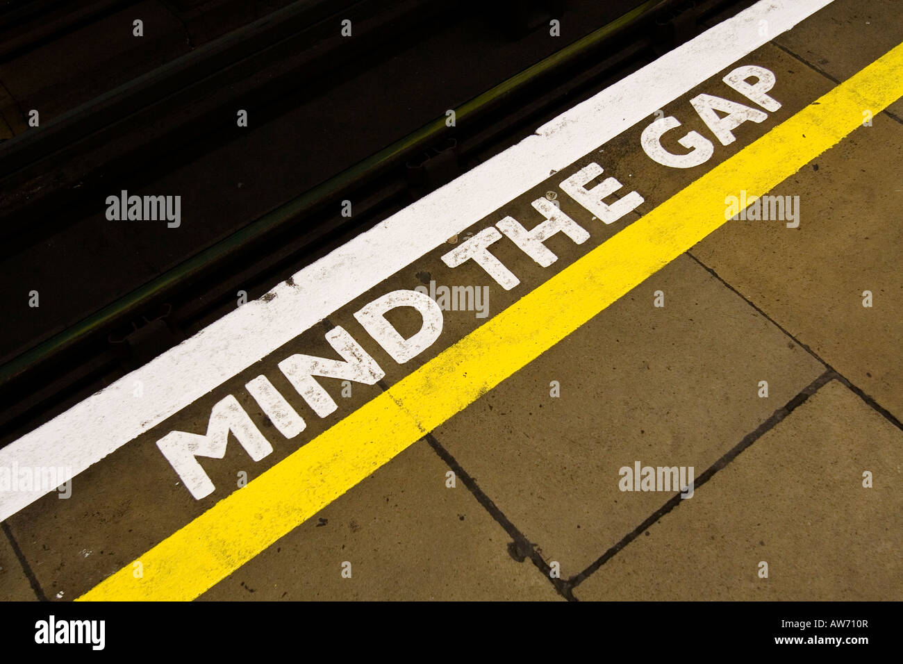 Mind the Gap sign on the edge of a London Underground Tube ...