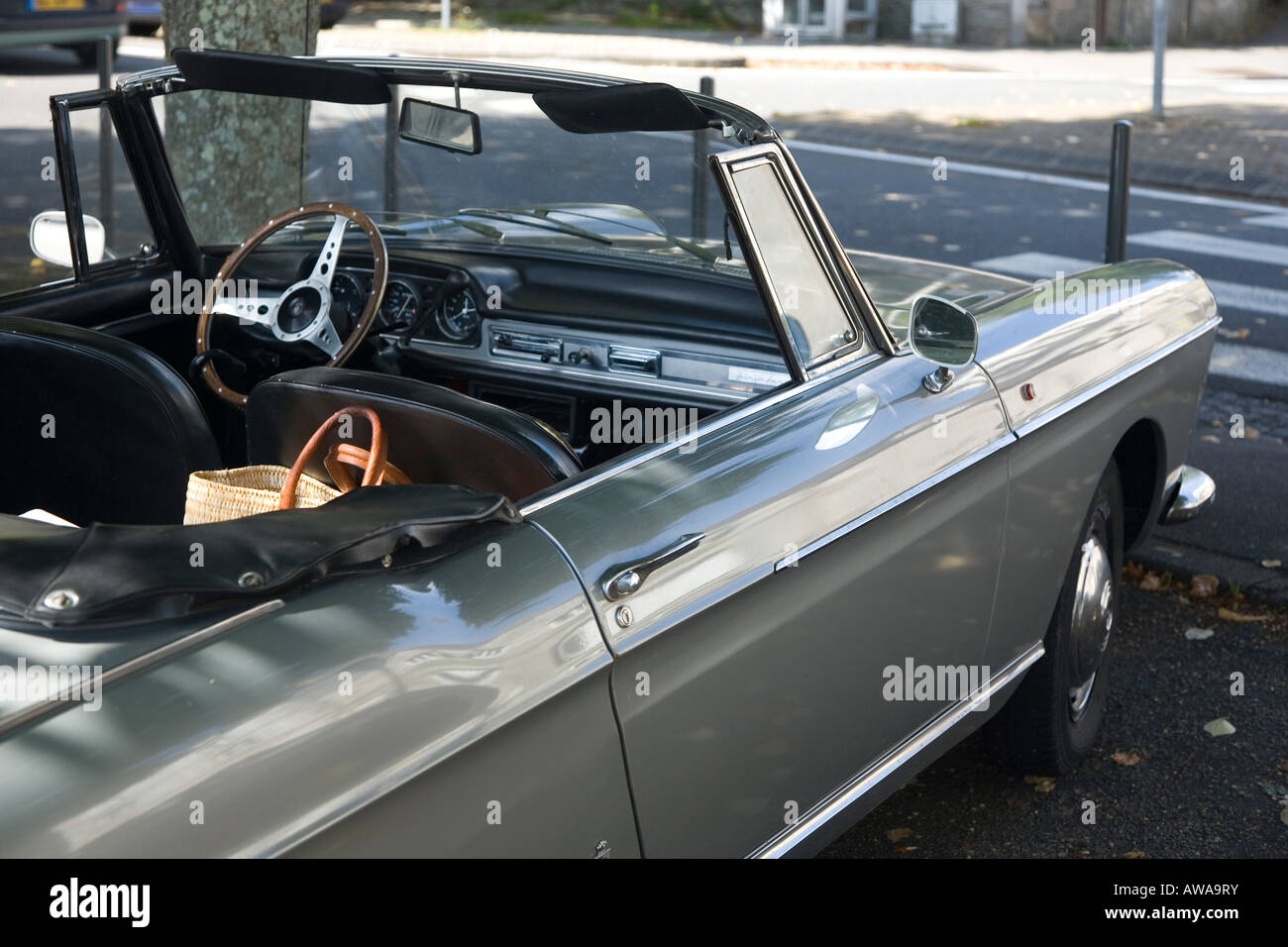 Old Peugeot convertible car parked in French street Stock Photo ...