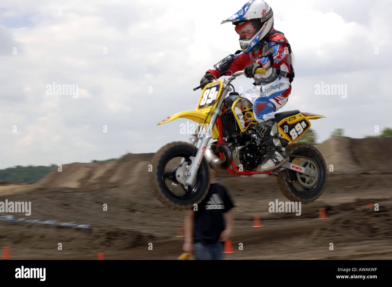 6 year old races on a honda 50 cc motorcyle in motocross race