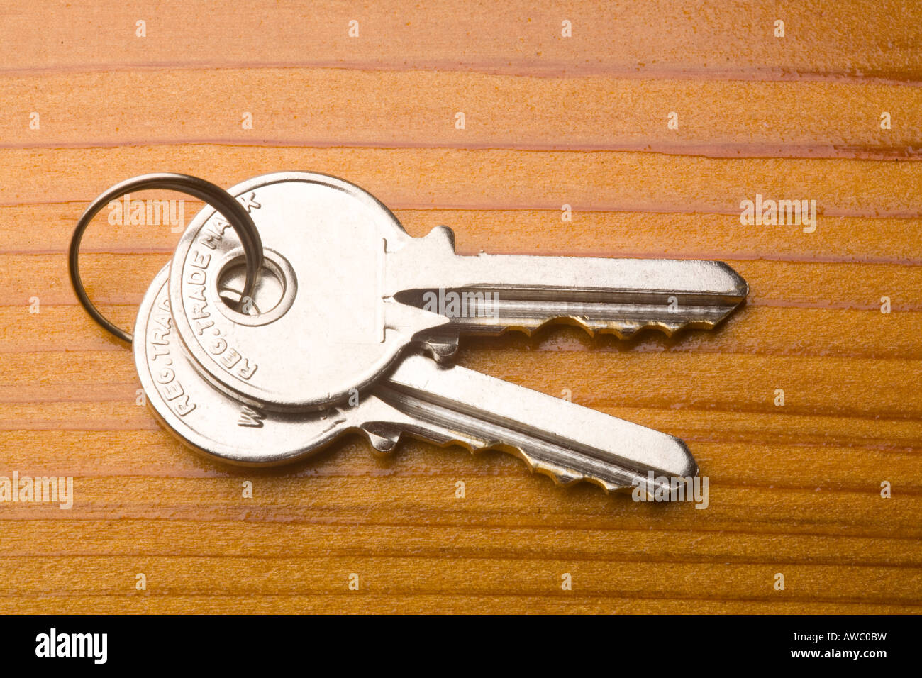 Pair of house keys on wooden table Stock Photo, Royalty ...
