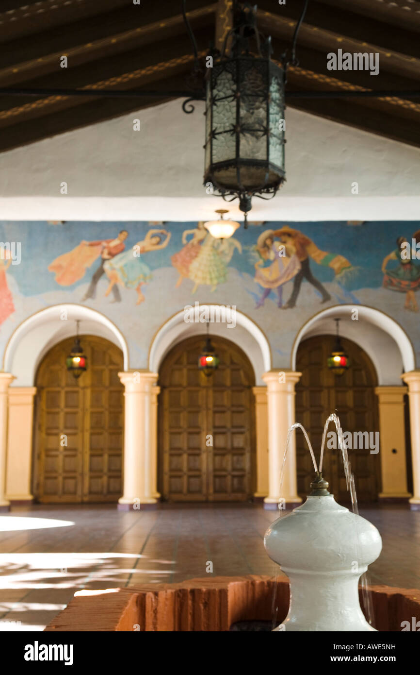California santa barbara arlington theater building arches and mural over entrance doors fountain in outdoor lobby