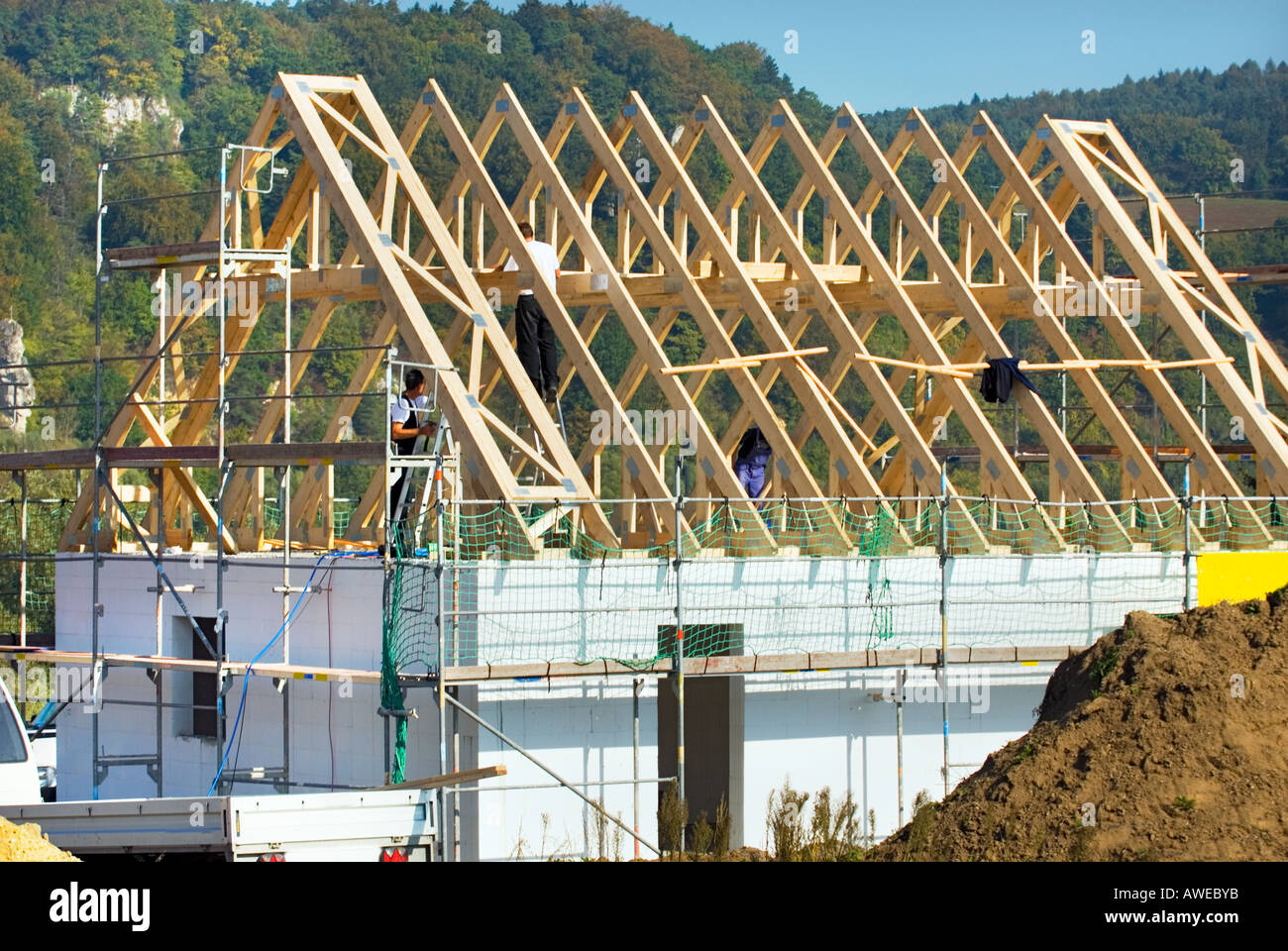 Roof truss timbers construction site brick wall cement for Building site house