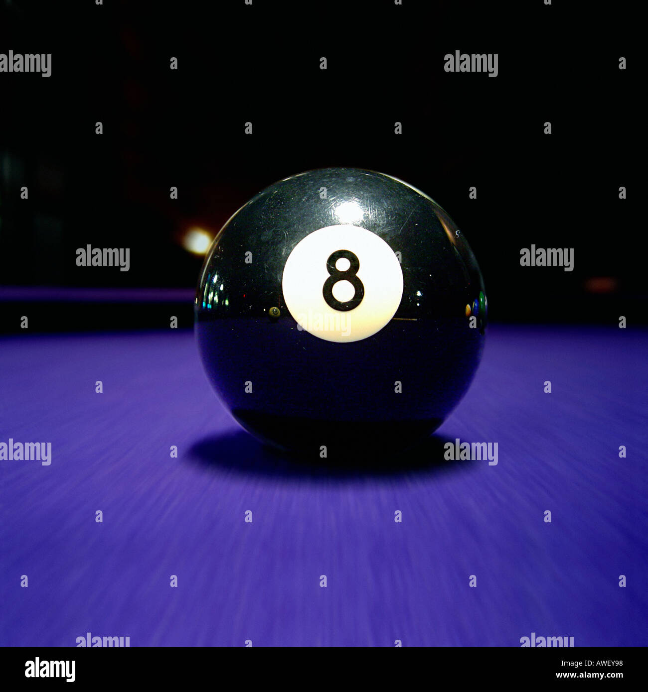 Closeup Of Eight Ball 8 Ball On Pool Billiards Table With Purple Felt Copy  Space