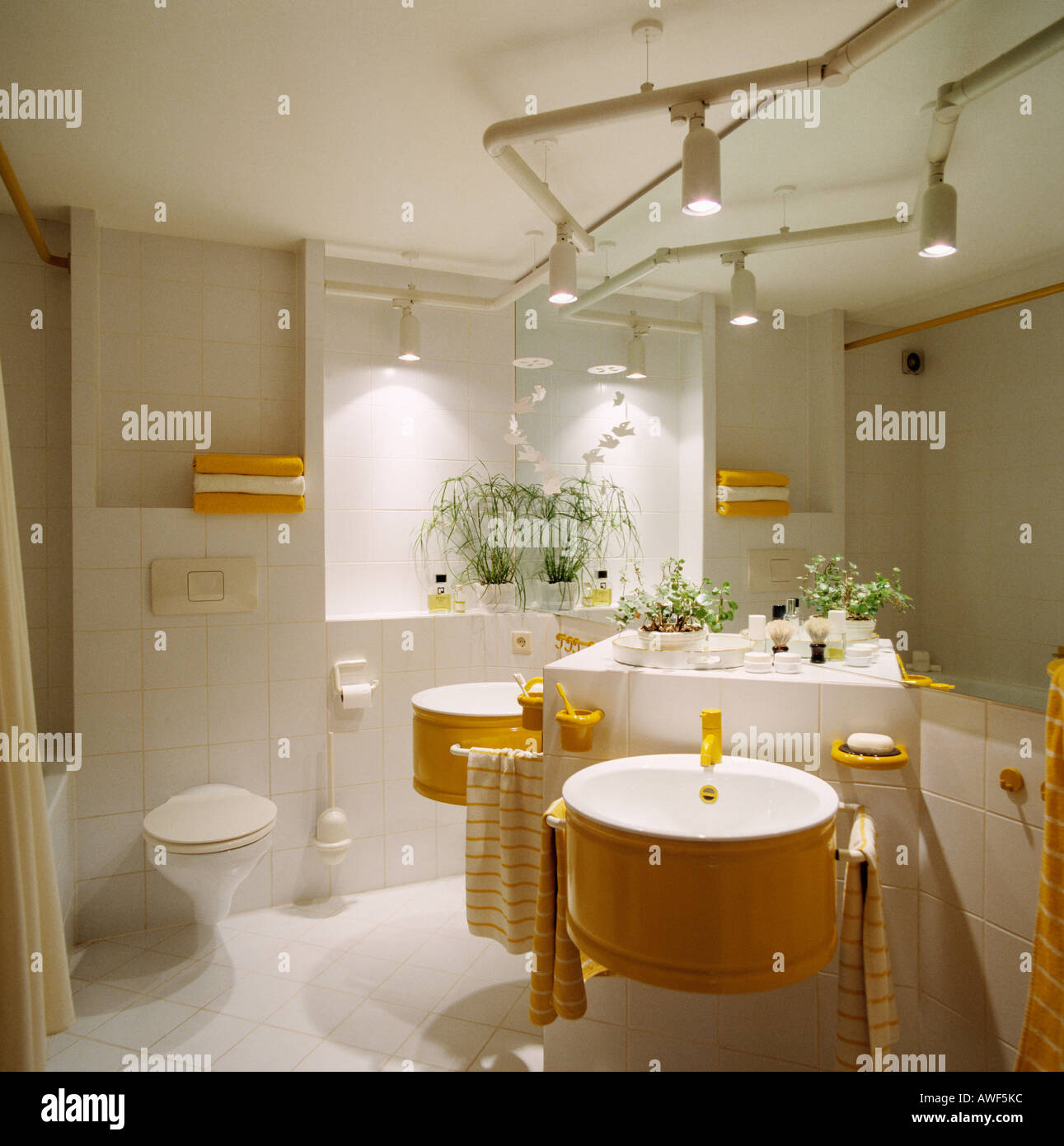 Stock Photo   Track Lighting Above Circular Basins On Fitted Vanity Unit In  Modern White Bathroom