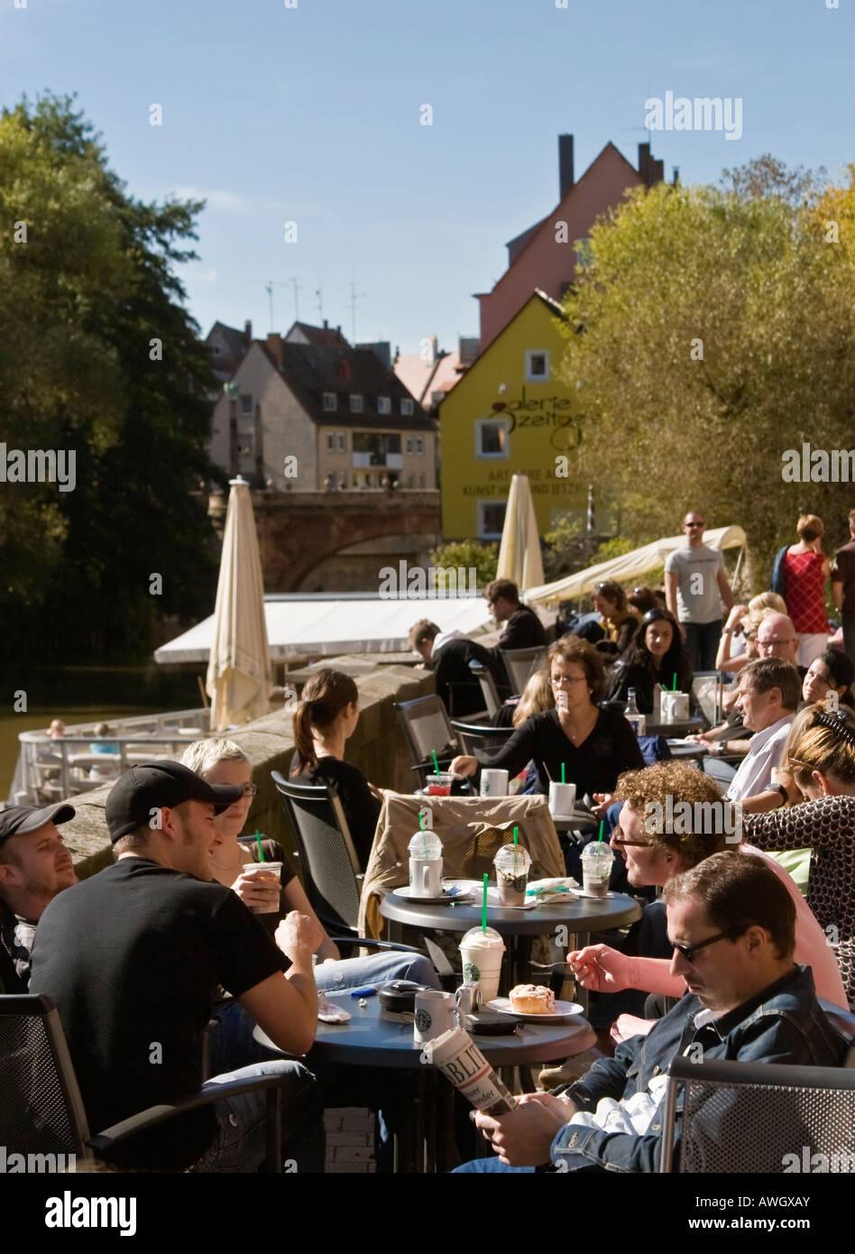 People At Riverside Starbucks Cafe Patio Pegnitz River Nuremberg Germany