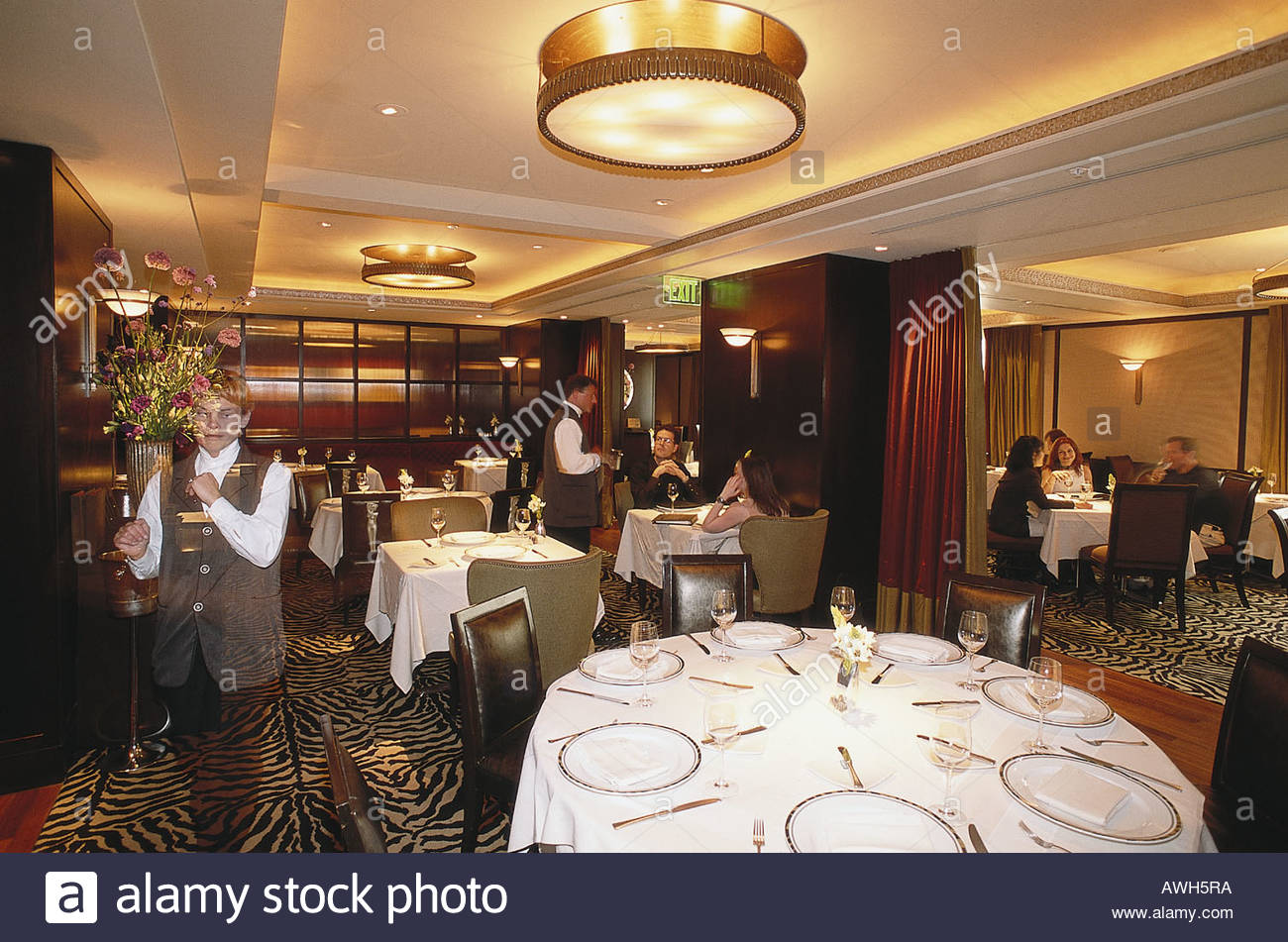 USA, California, San Francisco, Fifth Floor Restaurant, Waiter Serving  People Seated At Table, Blurred Motion