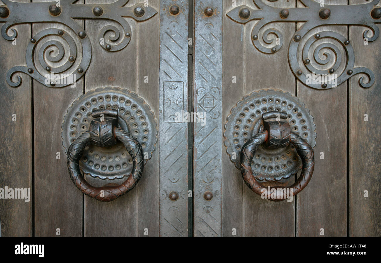 The wrought iron door handles hinges and trim on the main front the wrought iron door handles hinges and trim on the main front door of the cathedral of lisbon portugal rubansaba