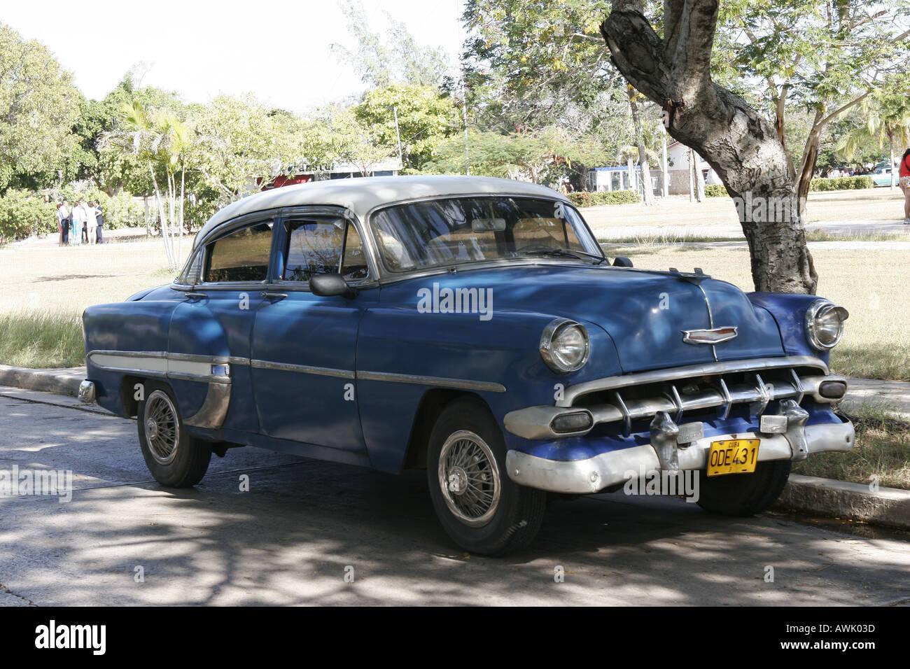 car Cuba street Holguin old antique driving Chevrolet Chevy blue ...
