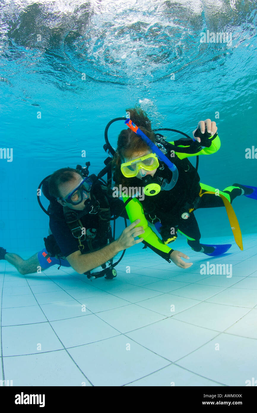 Scuba diving girls stock photos scuba diving girls stock images girl taking scuba lessons in a swimming pool indonesia asia stock image xflitez Choice Image