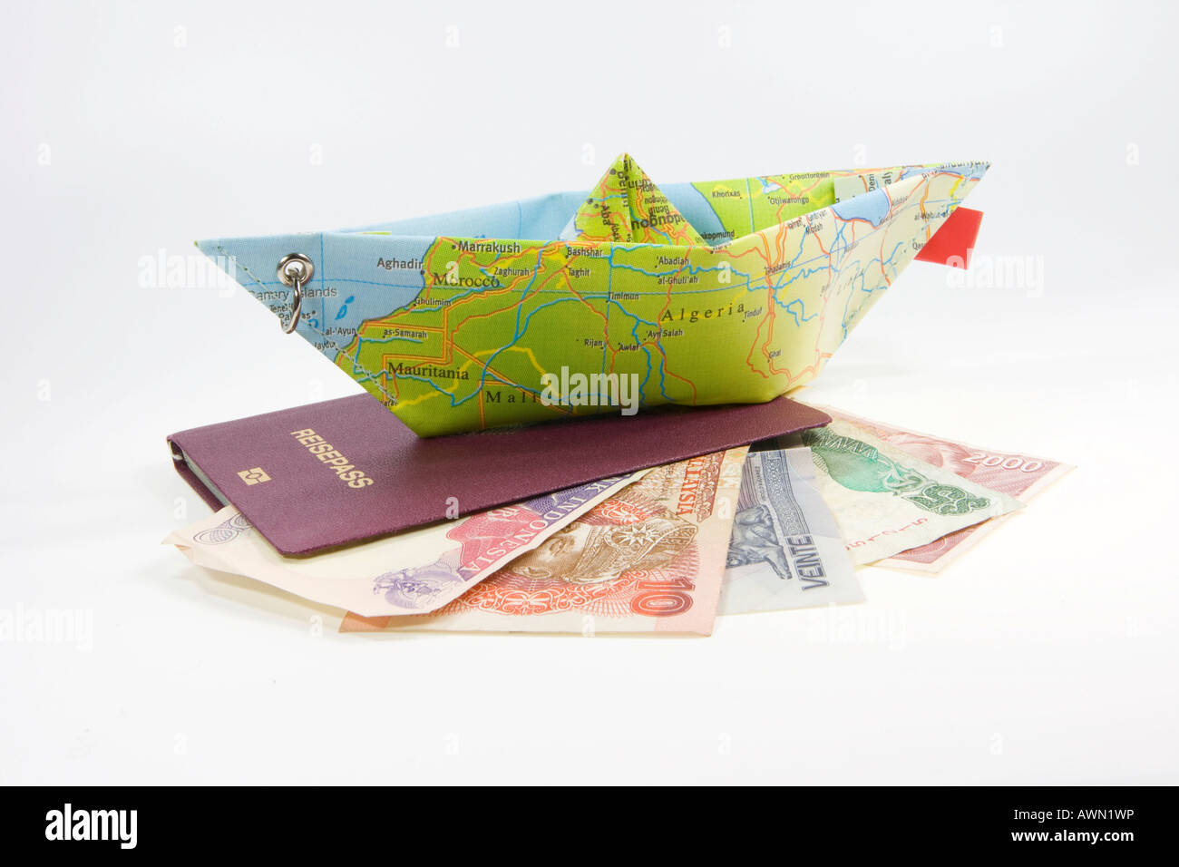 German passport foreign currency and a paper ship made from a map german passport foreign currency and a paper ship made from a map symbol for international travel buycottarizona